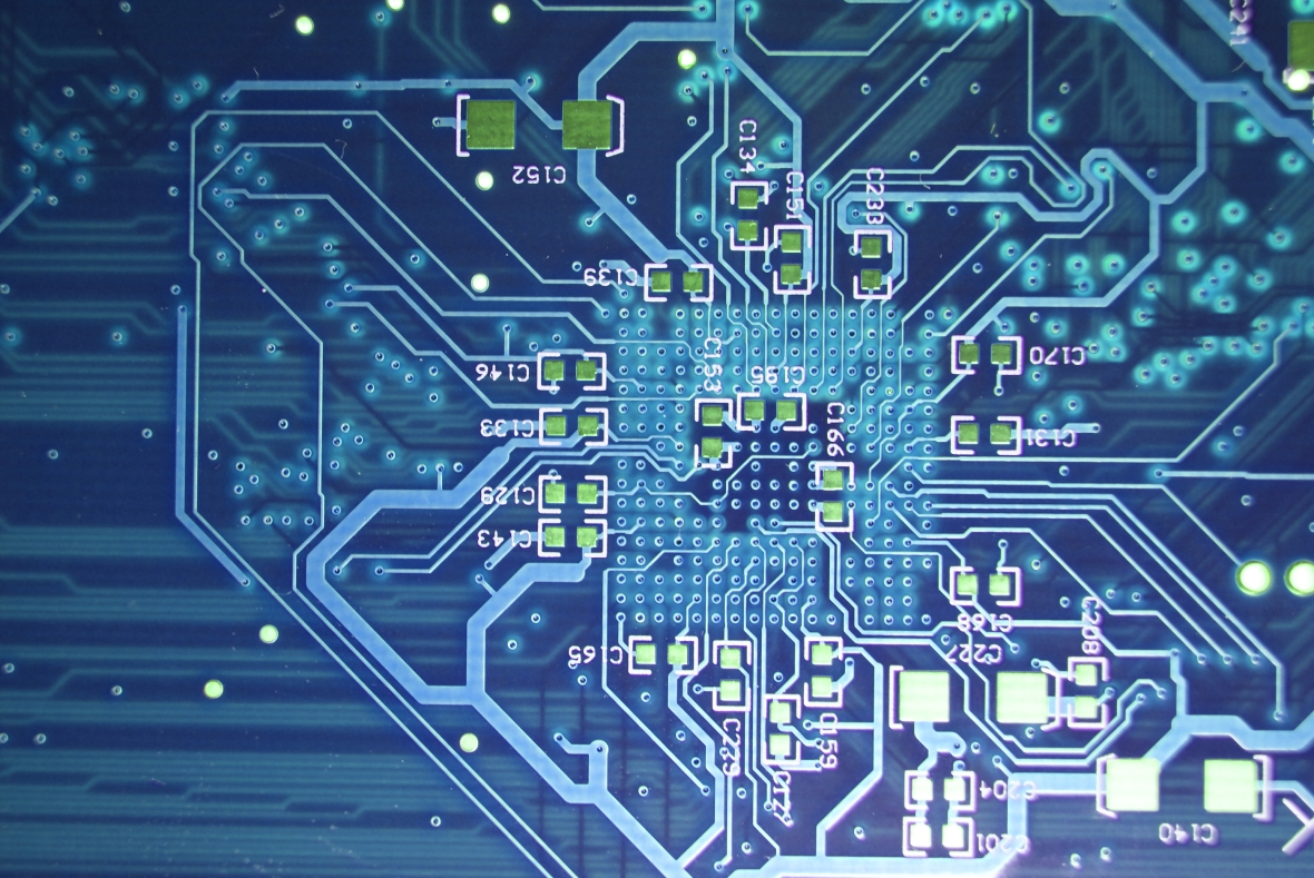Printed Circuit Board Blue Electronic Background Leading With Many Electrical Components Stock Photo